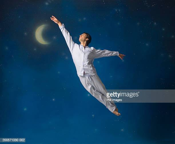 Man floating in mid-air with arms outstretched