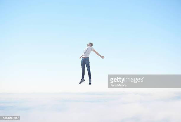 Man floating in sky