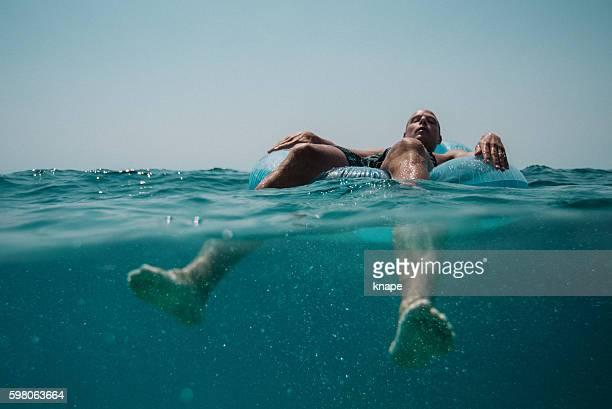 Man floating in the Mediterranean Sea in Croatia