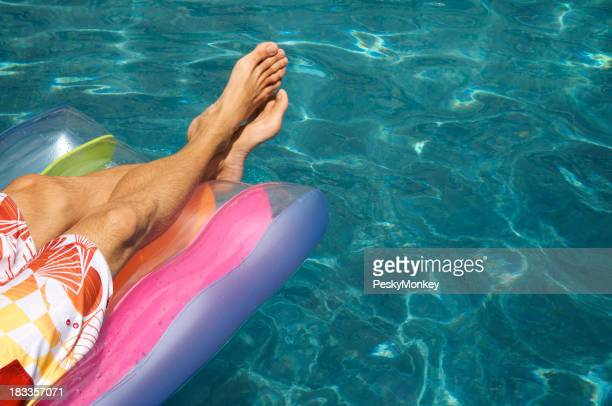 Man Floating on Pool Raft Wavy Blue Water