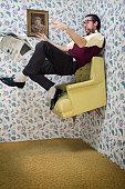 Man Floats Upward in Vintage Living Room Chair