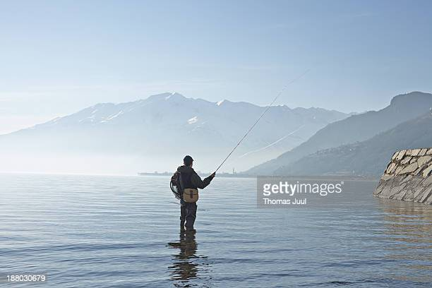 Man fly fishing in lake Como