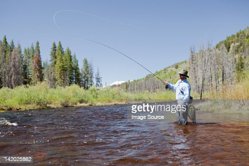 Man fly fishing in river, Colorado, USA : Stock Photo
