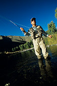 Man fly fishing in river, low angle view