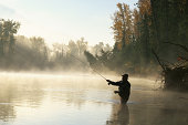 Man flyfishing in Elk River near Fernie