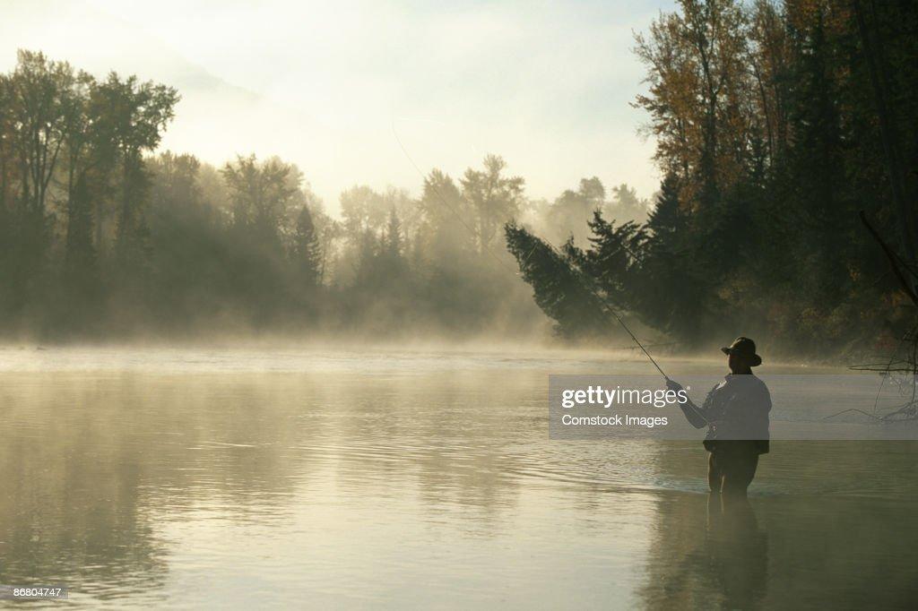Man flyfishing in elk river stock photo getty images for Elk river fishing