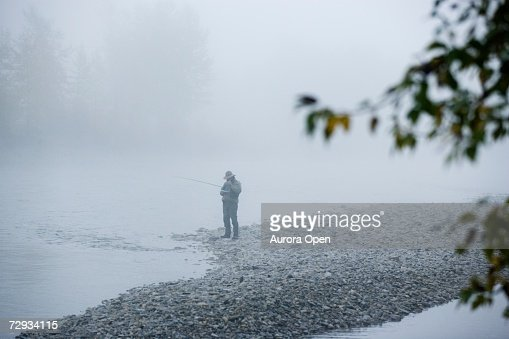 A man fly-fishing on Elk River, BC, Canada. : Stock Photo