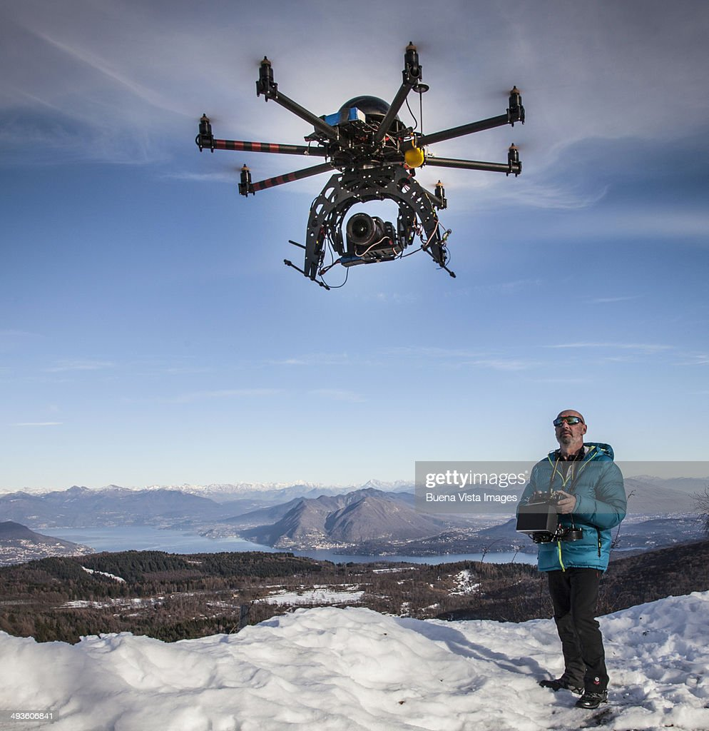 Man flying drone with camera