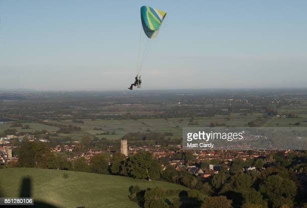 A man flying in a powered paraglider passes Glastonbury Tor near Glastonbury on September 22 2017 in Somerset England Today marks the start of the...