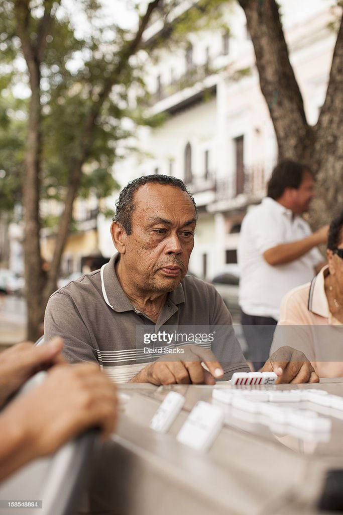 Man focused on dominos : Stock Photo