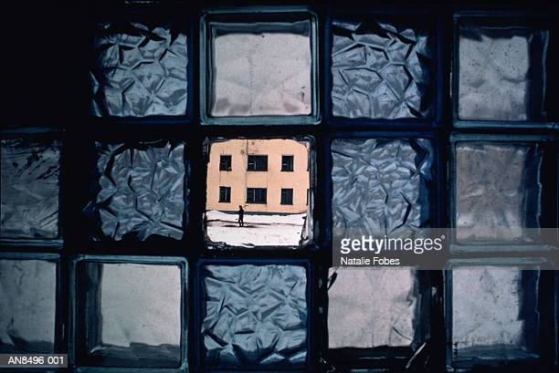Man framed by broken window, Providenija, Siberia, Russia