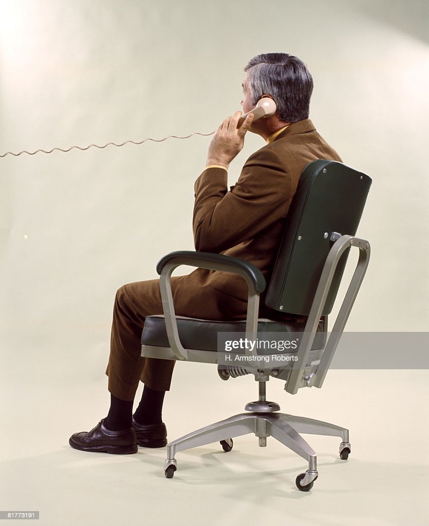 Man From Back Seated Metal Office Chair Talking On Telephone Men Business Businessman Businessmen. : Stock Photo