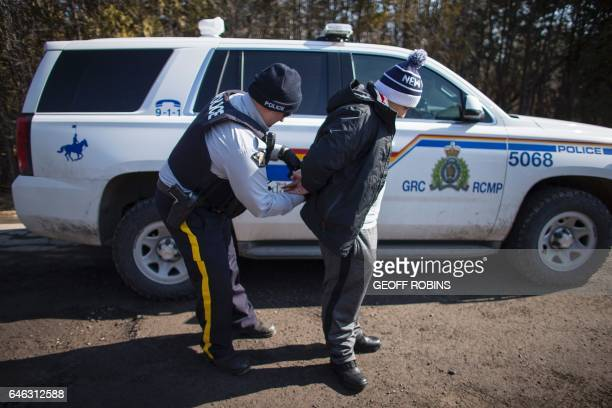 A man from Colombia is arrested by the RCMP after he and his wife and daughter illegally crossed the USCanada border near Hemmingford Quebec February...