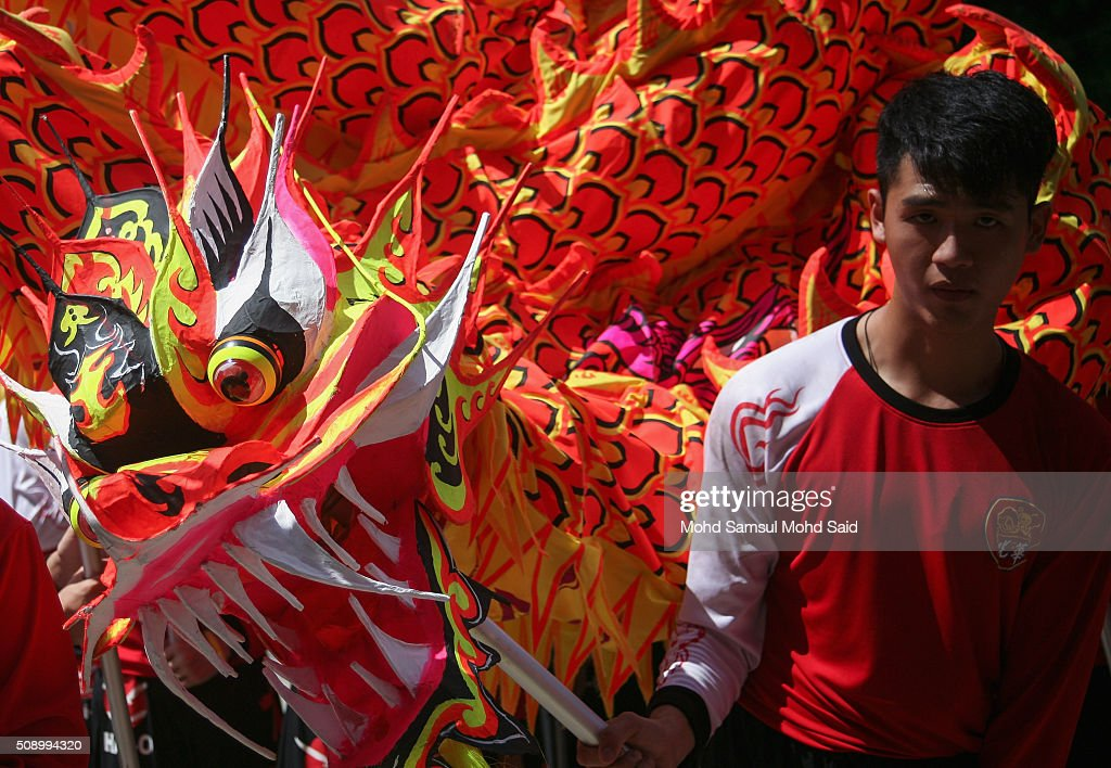 A man from group Dragon dance stand beside Dragon before start permence at the Guan Yin temple during Lunar New Year of the monkey celebrations on February 8, 2016 outside Kuala Lumpur, Malaysia. According to the Chinese Calendar, the Lunar New Year which falls on February 8 this year marks the Year of the Monkey, the Chinese Lunar New Year also known as the Spring Festival is celebrated from the first day of the first month of the lunar year and ends with Lantern Festival on the Fifteenth day.