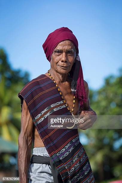 Man from Sangliat Dol village wearing a stole and head covering of locallywoven ikat cloth Yamdena island Tanimbar archipelago Maluku Indonesia