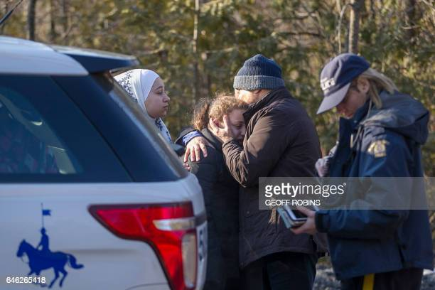 A man from Syria hugs his daughter after they were detained by the RCMP as they illegally crossed the USCanada border near Hemmingford Quebec...