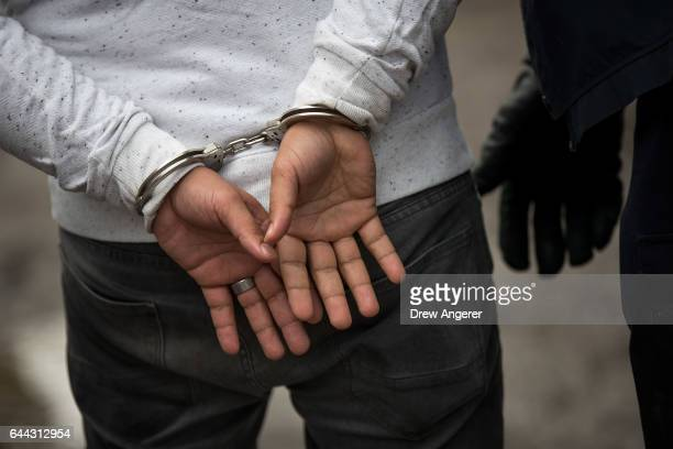 A man from Turkey is handcuffed by Royal Canadian Mounted Police after he crossed the USCanada border into Canada with his family February 23 2017 in...