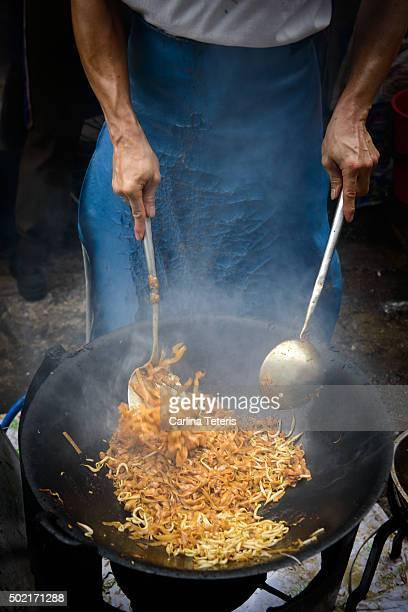 Man frying wok of Char Kway Tiao