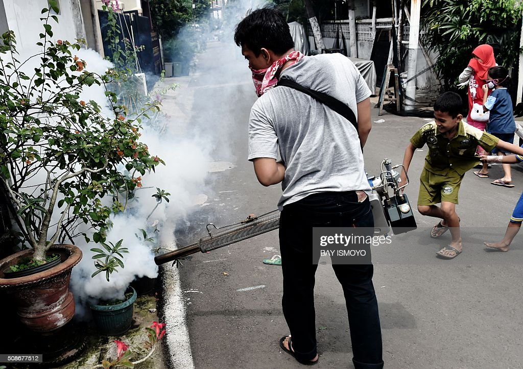 A man fumigates against the Aedes Aegypti mosquitos as a vector of the dengue and Zika viruses in Jakarta on February 6, 2016. Indonesia officially confirmed a case of the Zika virus dating back to last year but said it was prepared to handle any outbreak of the disease which has sparked alarm in the Americas. AFP PHOTO / Bay ISMOYO / AFP / BAY