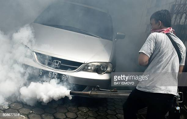 A man fumigates against the Aedes Aegypti mosquitos as a vector of the dengue and Zika viruses in Jakarta on February 6 2016 Indonesia officially...