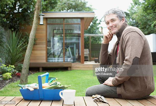 Man gardening in backyard