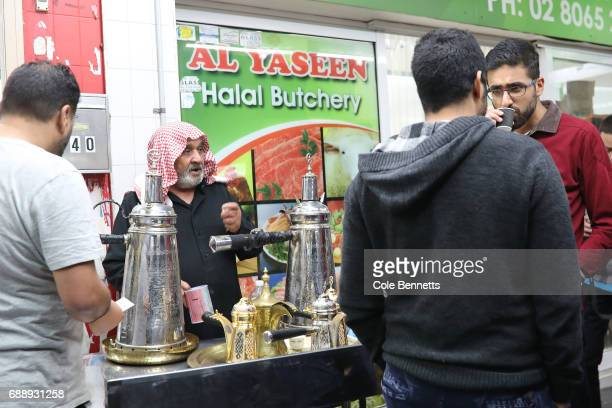 Man gather aroud an Arabic coffee stand during a street festival in the southwestern suburb of Lakemba on May 27 2017 in Sydney Australia Muslims...