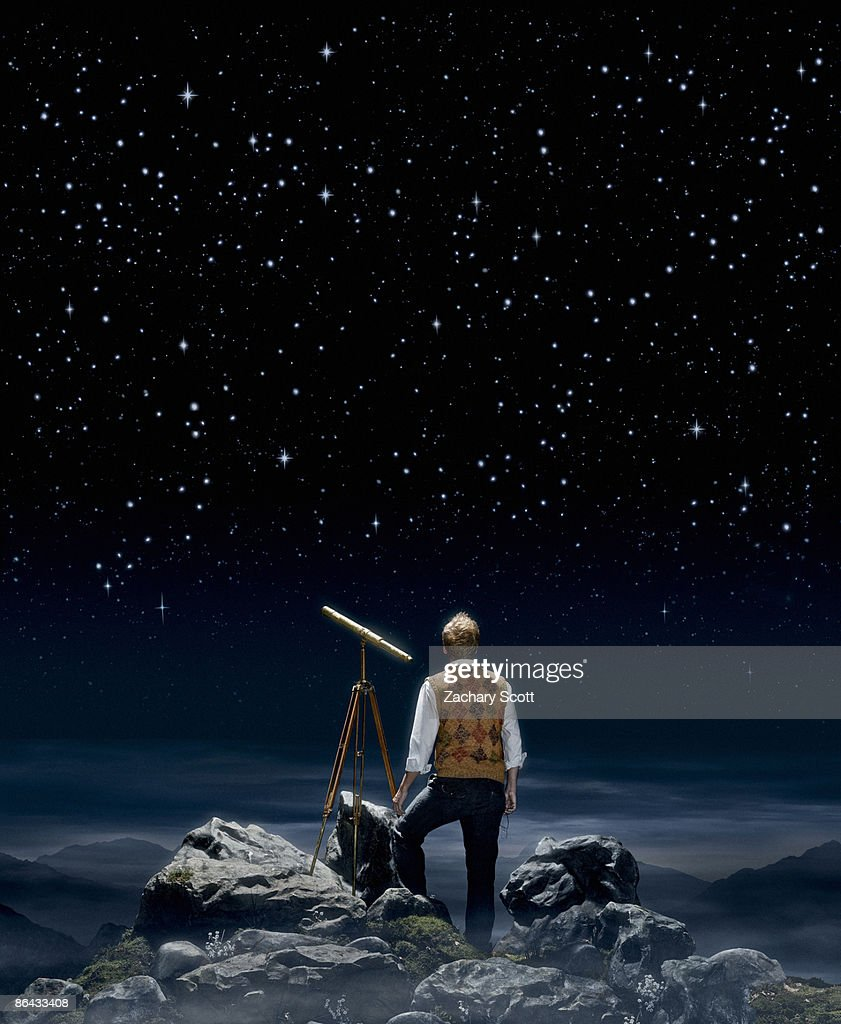 Man gazing at a night sky aside a telescope  : Stock Photo