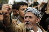 A man gestures as Houthi supporters stage a protest claiming that the United States obstructs the peaceful settlement in Yemen at Babul Yemen street...