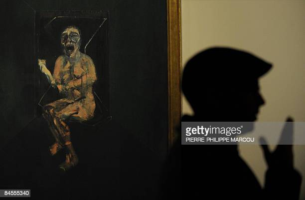 A man gestures next to Irish artist Francis Bacon's painting 'Study for the nurse from the battleship Potemkin' exhbited at Prado Museum in Madrid on...