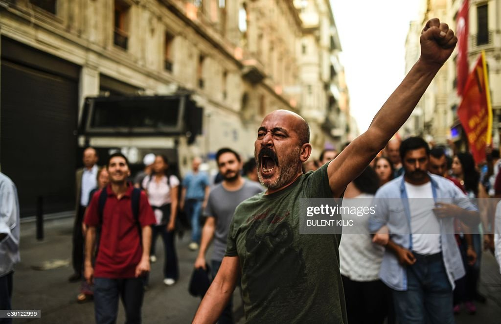A man gestures on May 31, 2016 in Istanbul, during a demonstration commemorating the third anniversary of the start of the Gezi Park protests. The Gezi Park protests which began in May 2013, were sparked by the heavy-handed eviction of demonstrators staging a sit-in protest against the redevelopment of the area and grew into often violent clashes with police as people demonstrated against much broader issues concerning perceived infringements of civil rights. / AFP / BULENT
