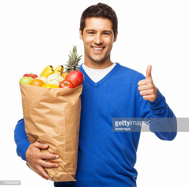 Man Gesturing Thumbs Up While Carrying Bag Of Groceries-Isolated