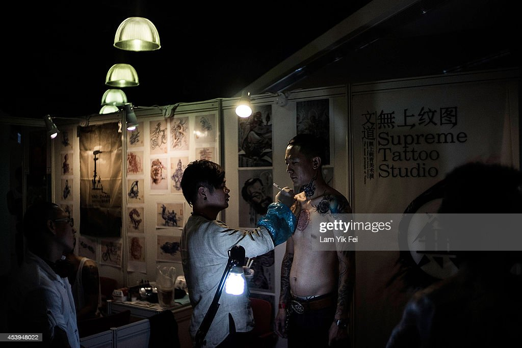 A man gets a tattoo at the Hong Kong Tattoo Convention on August 22, 2014. in Hong Kong. The 2nd International Hong Kong Tattoo Convention 2014 features tattoo artists from around the world.