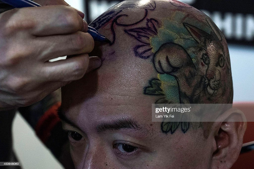 A man gets a tattoo on his head at the Hong Kong Tattoo Convention on August 22, 2014. in Hong Kong. The 2nd International Hong Kong Tattoo Convention 2014 features tattoo artists from around the world.