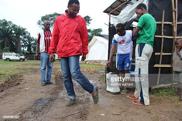 A man gets disinfected prior to enter a health centre of the NGO Doctors without borders on October 6 2014 in Lokolia as part of prophylactic...