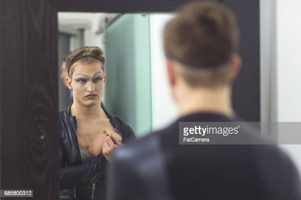 Man gets dressed in drag attire in bathroom