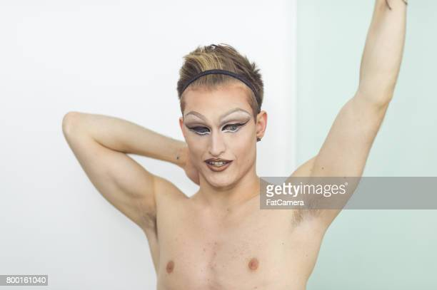 Man gets dressed in drag attire in bathroom