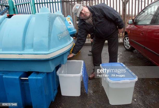 A man gets drinking water at Whiterock leisure centre in Belfast as tens of thousands of homes and businesses are still without supplies as engineers...