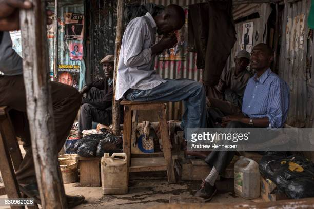 A man gets his shoes shined in the Kibera slum on August 13 2017 in Nairobi Kenya A day prior demonstrations turned violent in some areas throughout...