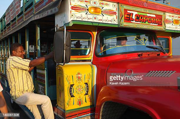 CARTAGENA of INDIAS COLOMBIA JANUARY 27 2012 A man gets inside a typical colorful Colombian bus on January 27 2012 in Cartagena Colombia