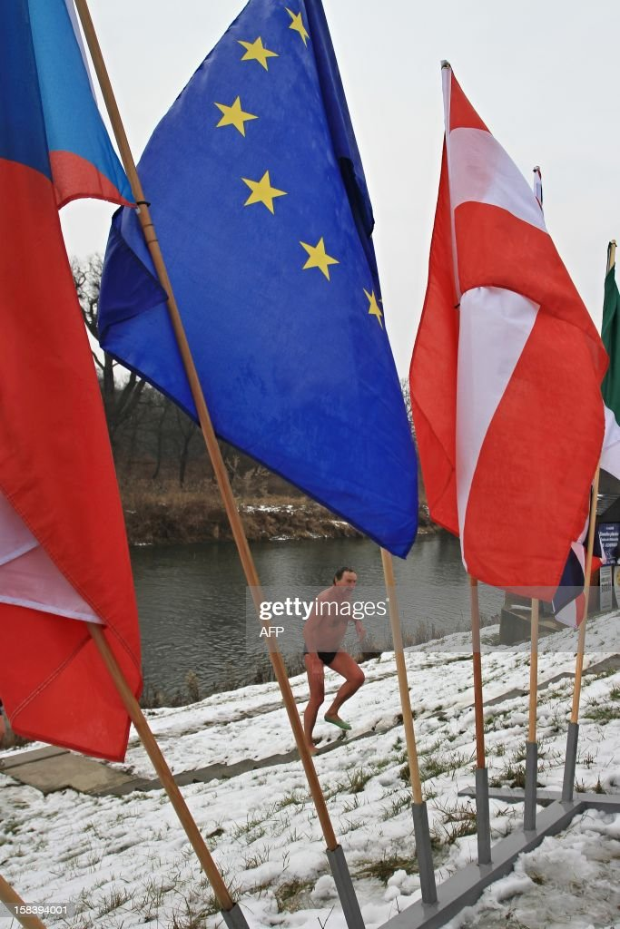 A man gets off the river Thaya at the border to Austria near Breclav, Czech Republic on December 15, 2012. Winter swimmers celebrated the entry of the Czech Republic to the Schengen area on December 21, 2007 and commemorated the victims shot by soldiers in crossing the border to Austria under communism.