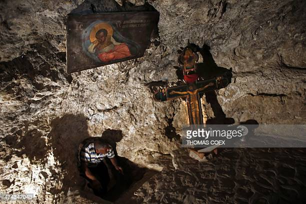 A man gets out of a chapel built on the rock inside the Orthodox Christian monastery of the Temptation near the West Bank city of Jericho on February...