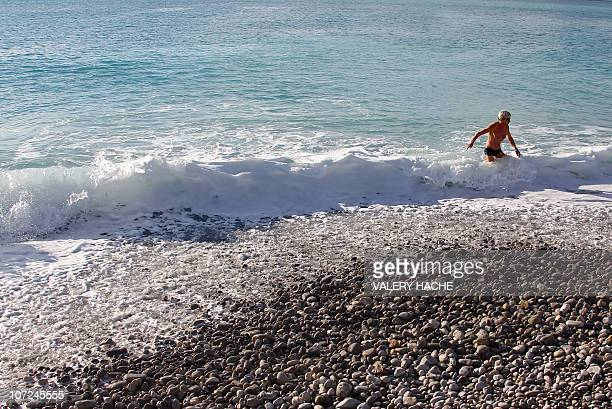 A man gets out the mediterranean sea after swimming under a sunny sky on November 27 2010 in Nice southeastern France AFP PHOTO VALERY HACHE