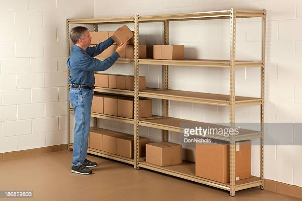 Man Getting a Box From Storage