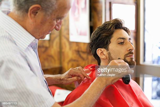 man getting a shave at barber shop