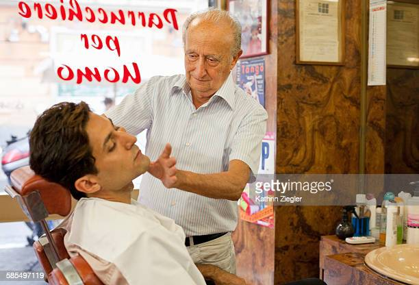 man getting a shave at old-fashioned barber shop
