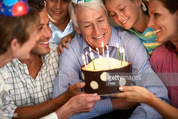 Man Getting Cake at Birthday Party