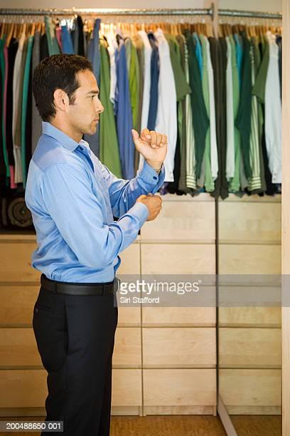 Man getting dressed inside walk-in closet