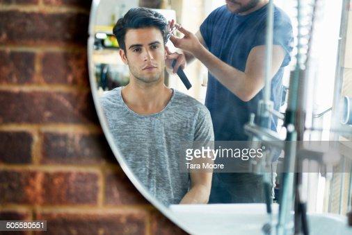 man getting hair cut