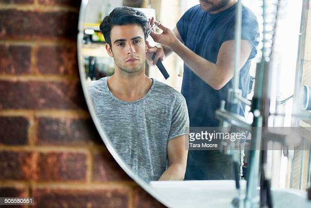 man getting hair cut