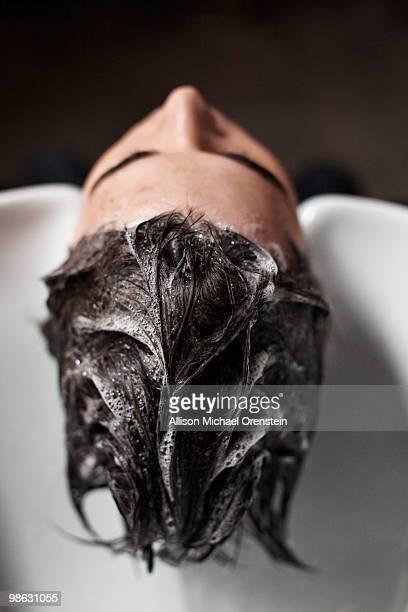 man getting hair washed in salon sink